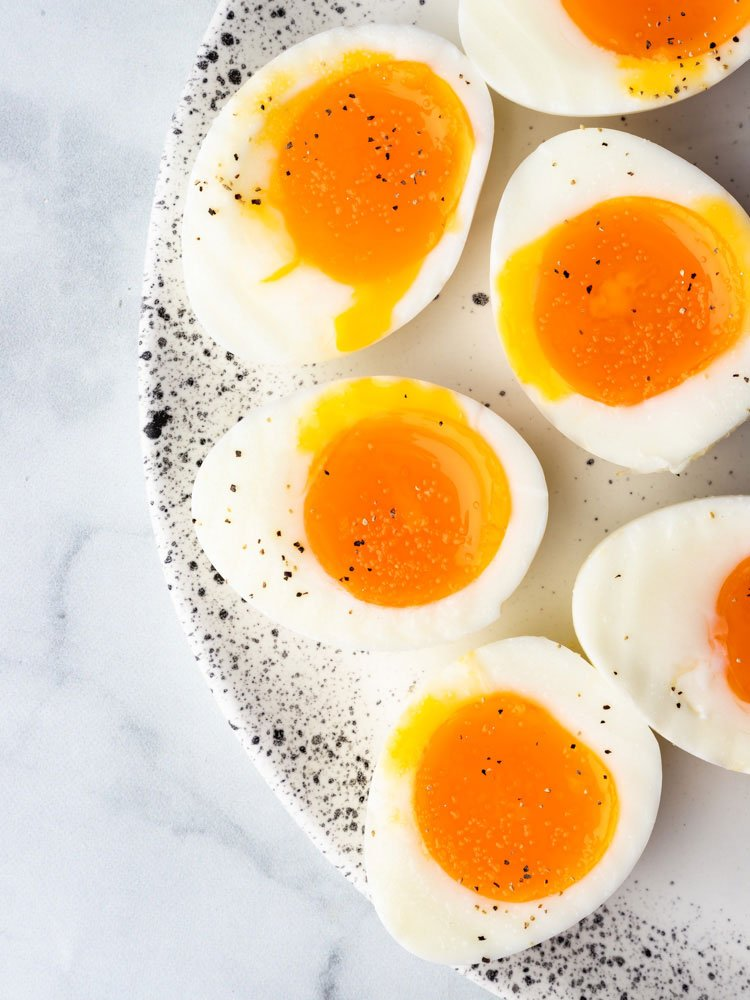 soft boiled eggs cut in half to show the runny yolk center