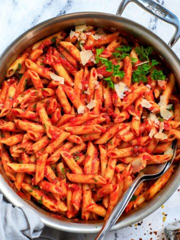 Top down shot of spicy arrabbiata pasta in a pot.