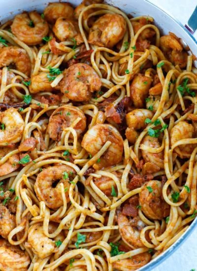 Overhead shot of spicy shrimp pasta in a skillet.