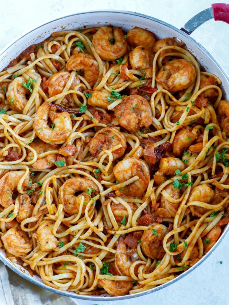 Top down shot of shrimp pasta in a skillet.