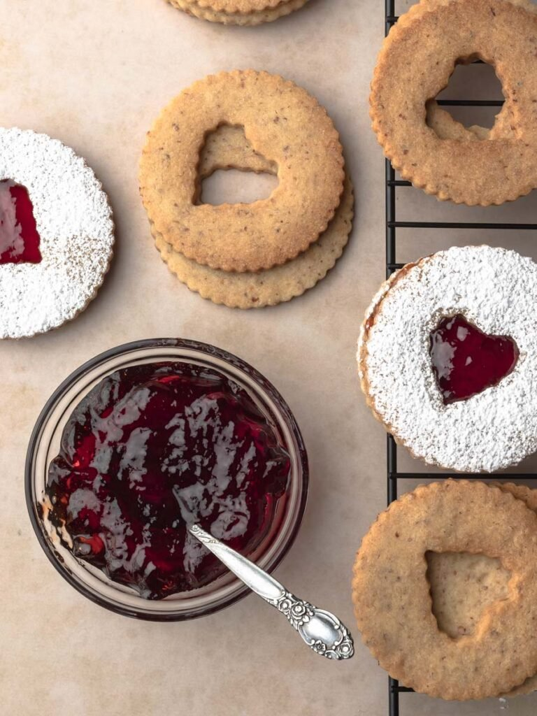 Overhead image of assembling the strawberry jelly linzer cookies.