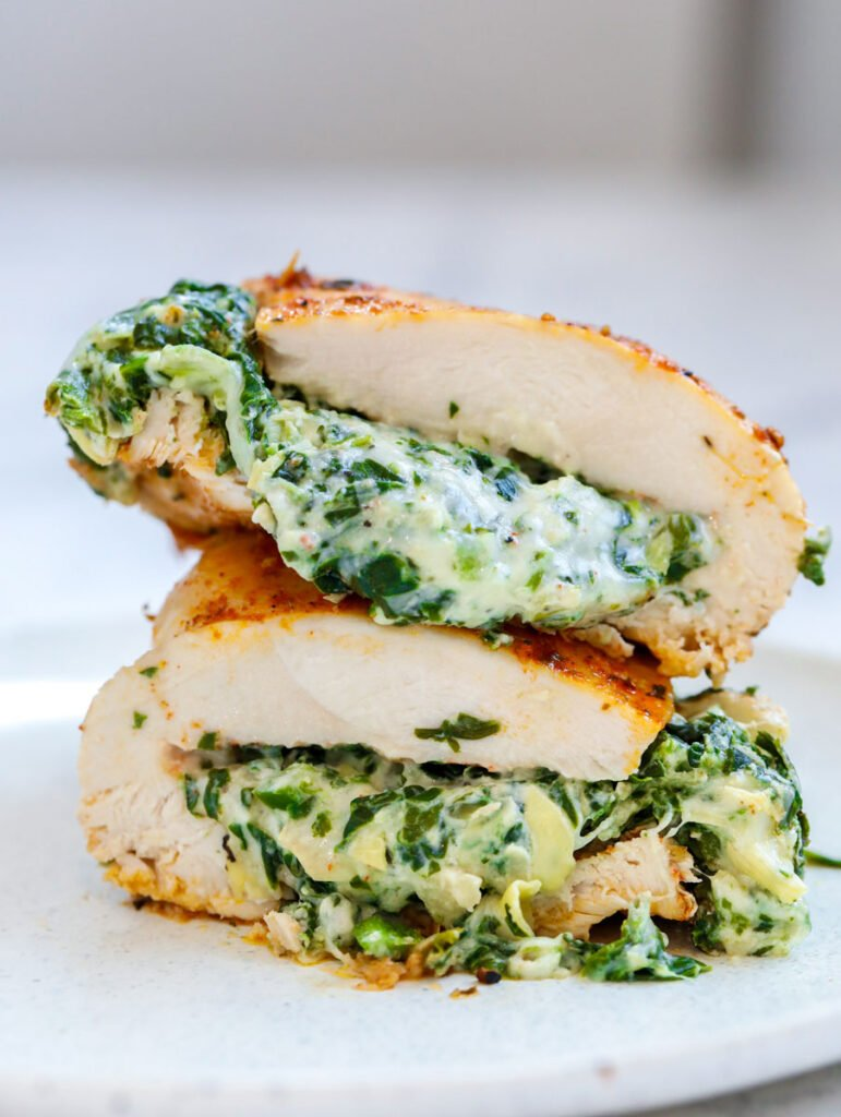 Spinach stuffed chicken breast cut in half and stacked on top of each other.