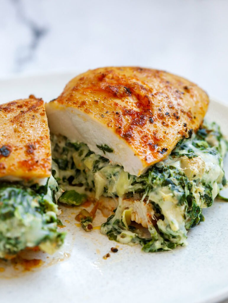 Close up of Spinach stuffed chicken breast cut in half.