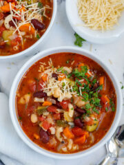Top down shot of vegetable minestrone soup in two bowls.