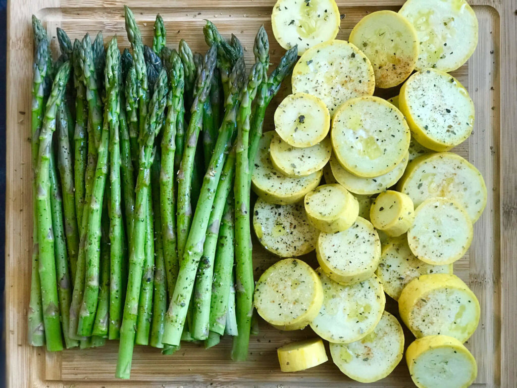 Asparagus and squash with spices sprinkled on them