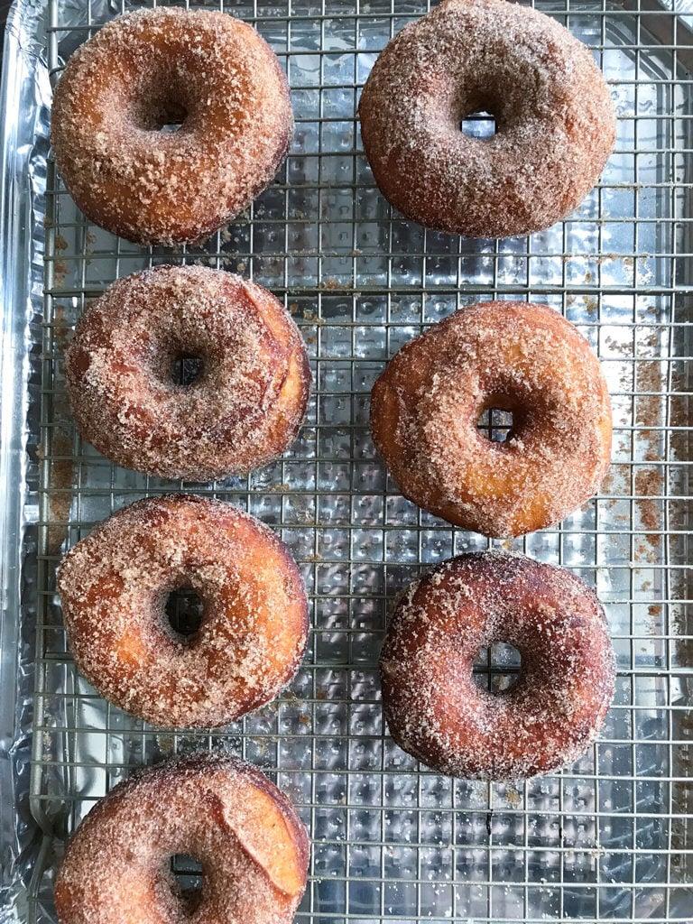 Cinnamon Sugar Donuts on a wire rack.