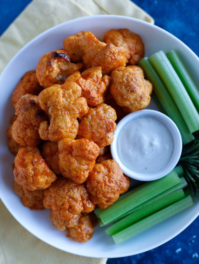 Buffalo Cauliflower Wings on a plate with dip