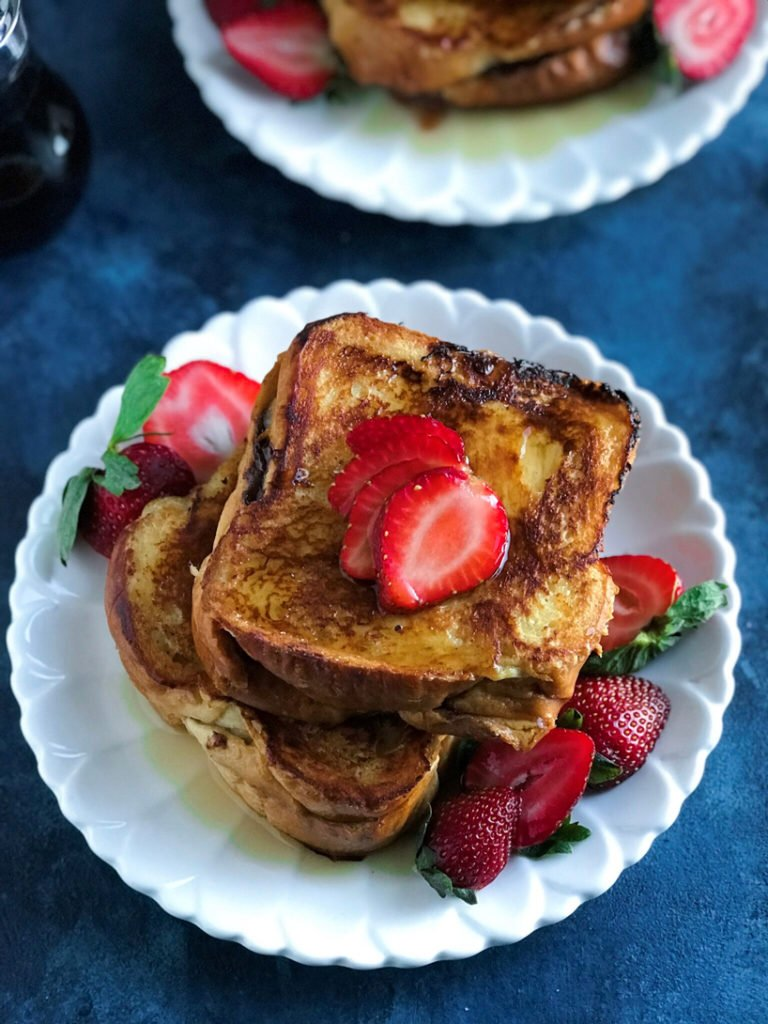 A stack of strawberry nutella french toast on a plate.