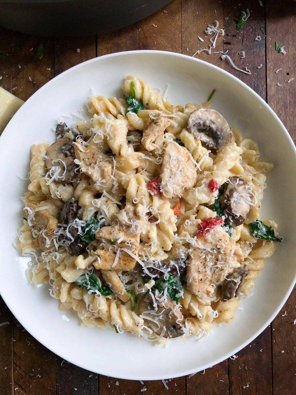 Serving Creamy Chicken and Mushroom Pasta