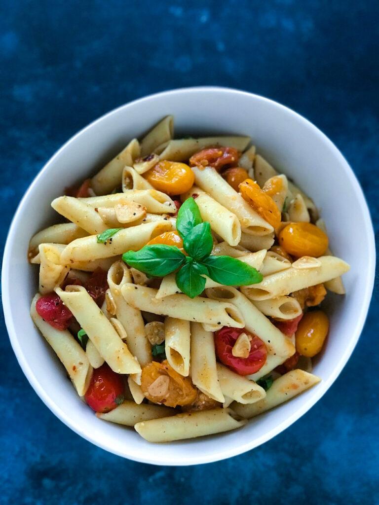 Simple Tomato Pesto Pasta served in a white bowl