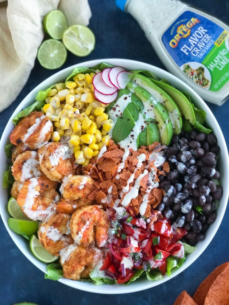 Shrimp Taco Bowl topping it with a delicious sauce to make it juicy