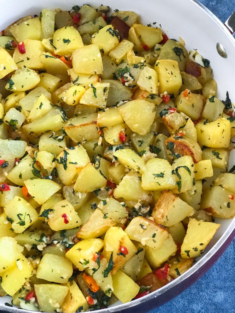 Lebanese Spicy Potatoes in a skillet ready to serve