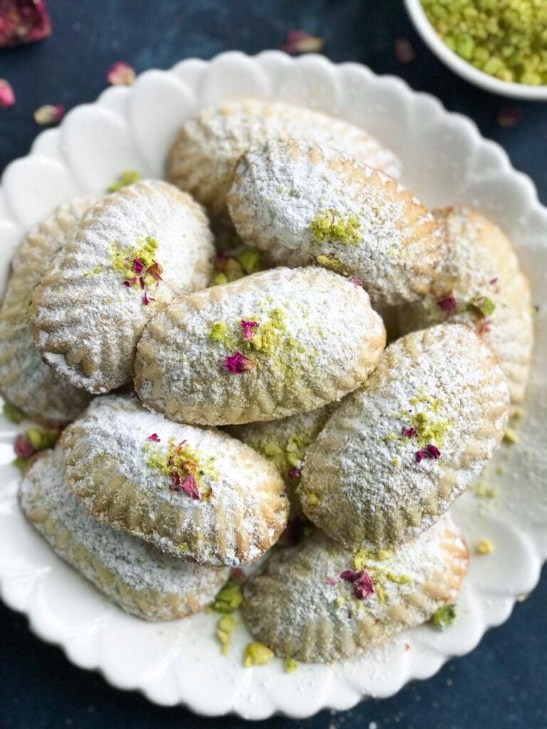Pistashio Maamoul Cookies ( معمول بالفستق ) on a white plate