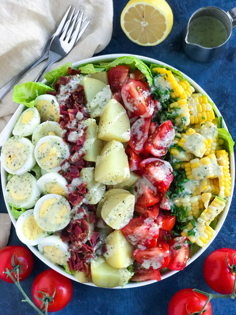 Potato Cobb Salad served in a large white bowl