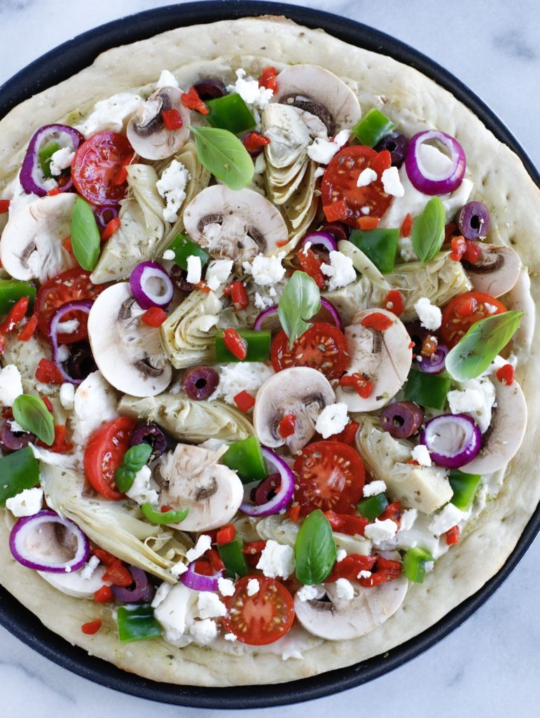 Top down shot of Mediterranean Veggie Pizza