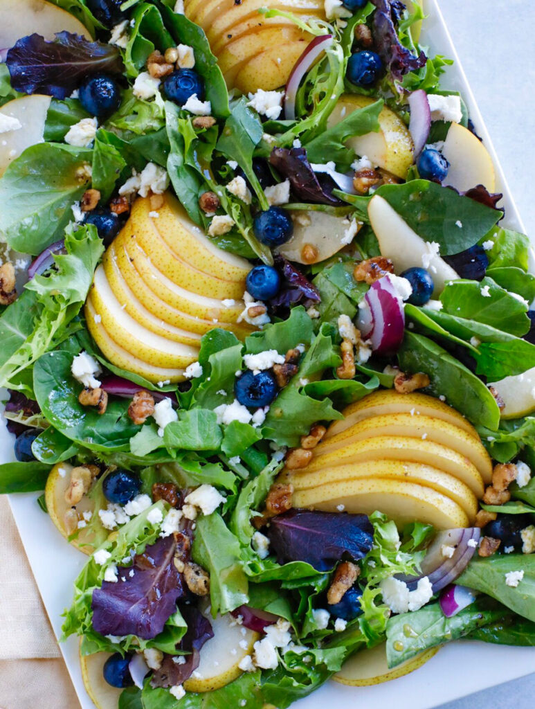 fall salad on a white plate.