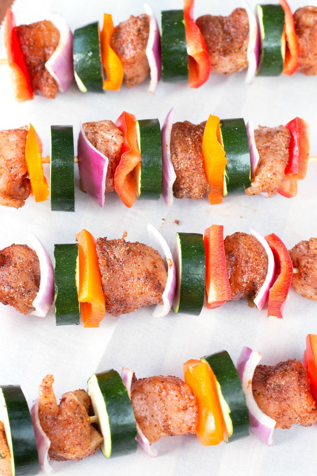 Chicken skewers with vegetables seasoned and waiting to be cooked