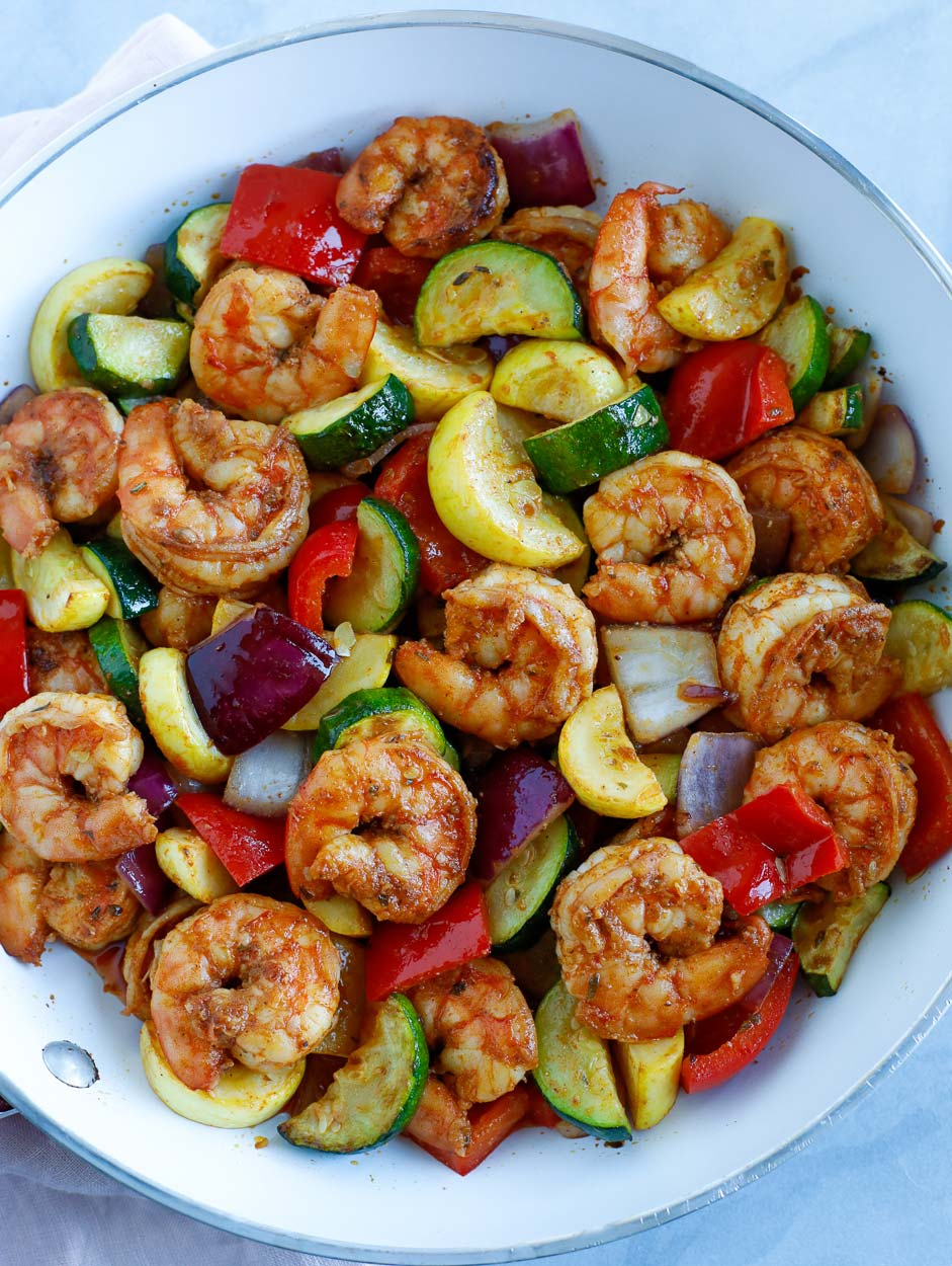 Shrimp and Vegetable cooked in a white skillet.