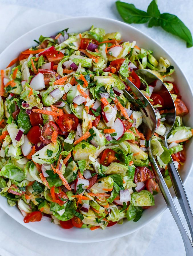 brussels sprouts salad in a white bowl