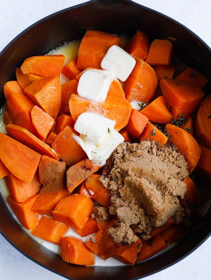 sweet potatoes with milk, sugar and butter in a pan