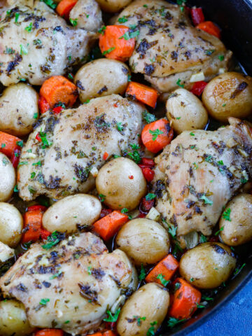 Oven Baked Chicken and Potatoes in a skillet