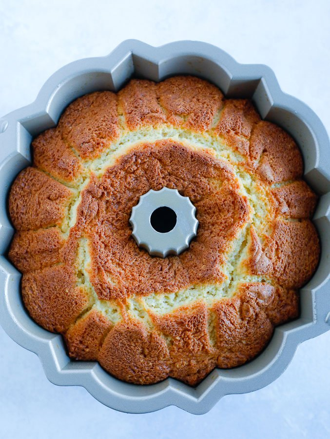 Top down view of bundt cake in a pan.