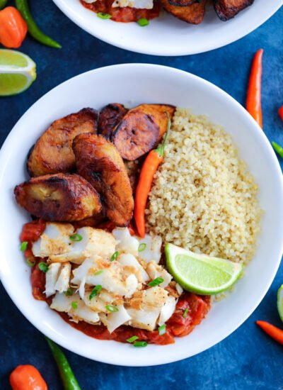 Caribbean Jerk Fish, quinoa, tomato sauce, and fried plantains topped with chilies