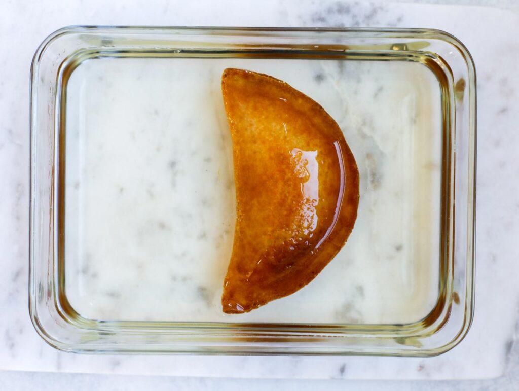 fried atayef dipped in sugar syrup