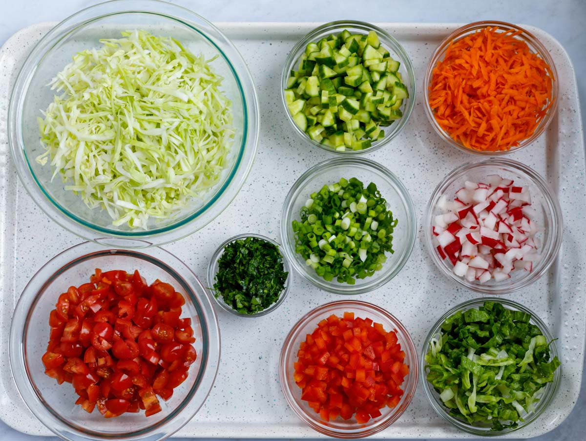 Ingredinets for the salad in glass bowls