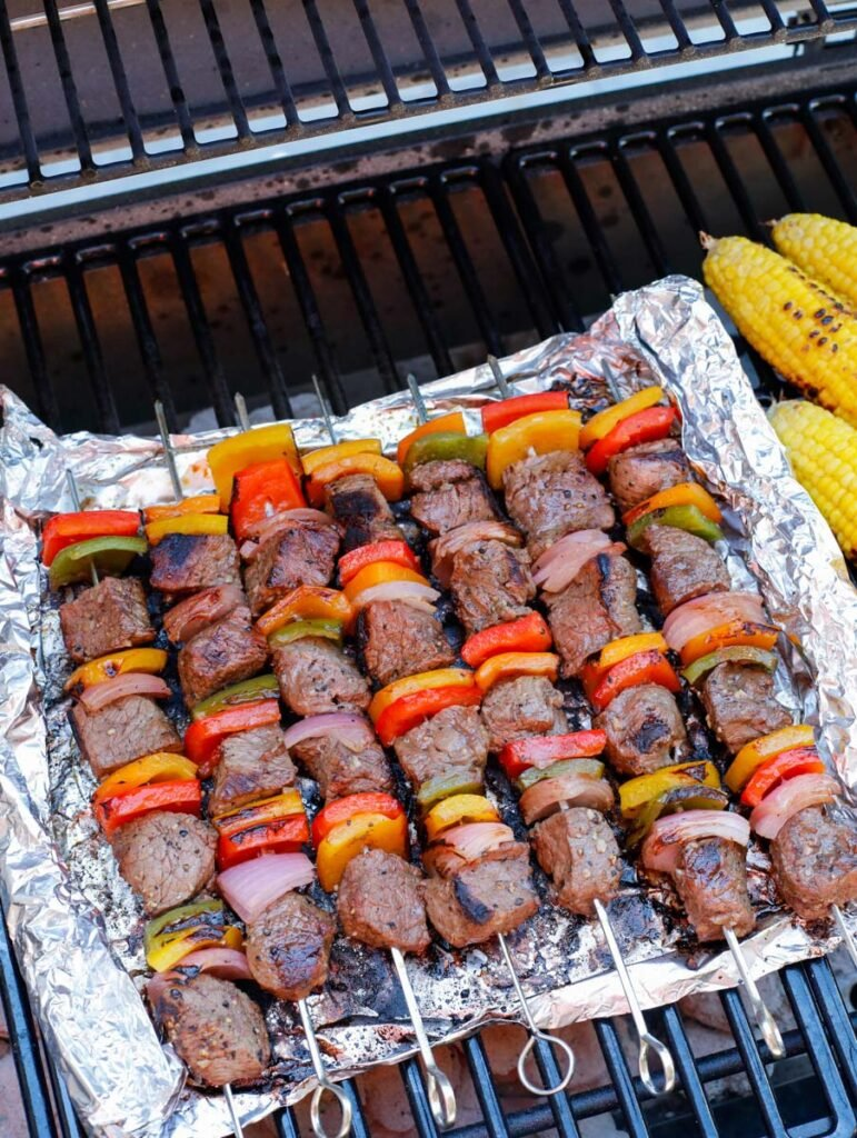 Beef kebobs on foil on the grill