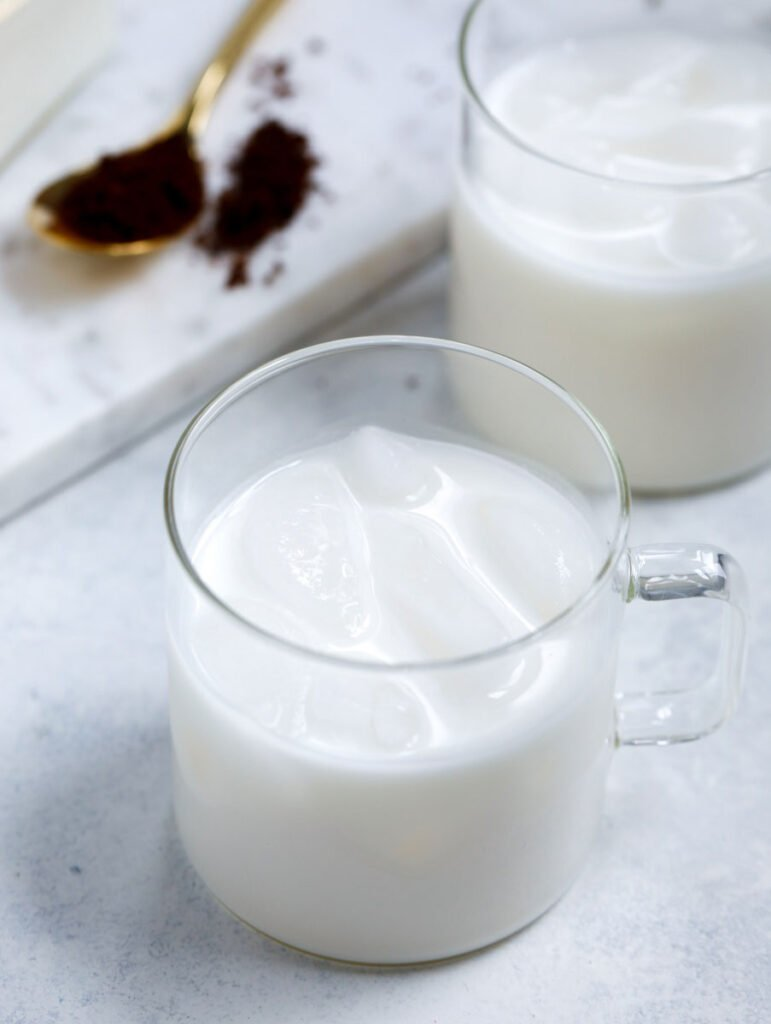 a cup of milk with ice