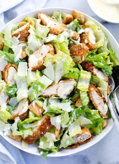 chicken caesar salad served in a dish