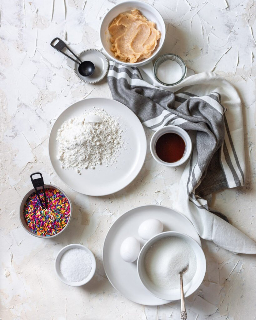 Ingredients of the cookies styled in plates and bowls