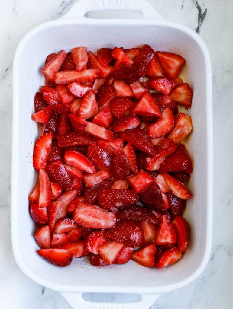 strawberry crisp filling in a baking dish