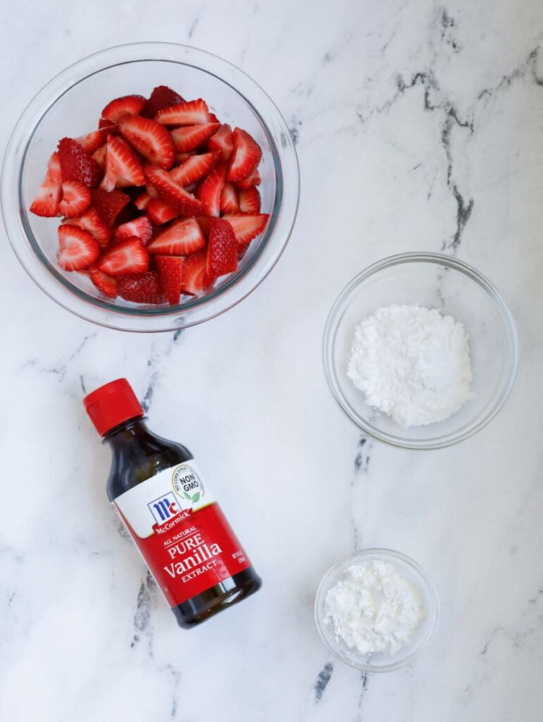 strawberry crisp filling ingredients: vanilla extracts, icing sugar, corn starch and fresh strawberries