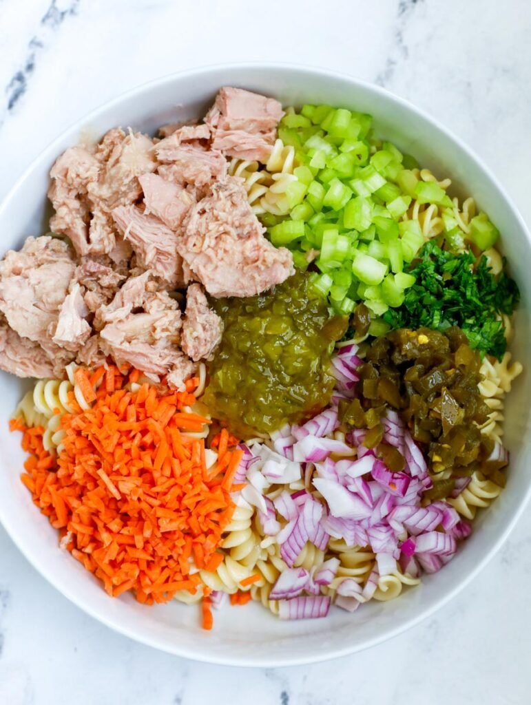 Tuna Pasta Salad ingredients in a white bowl