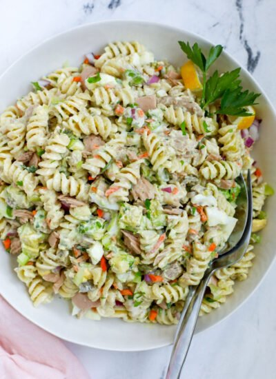 tuna pasta salad top down view with spoons inserted in the salad