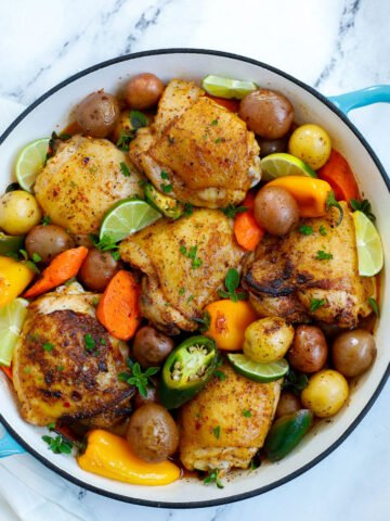 chicken and potato bake after cooking, garnished with parsley