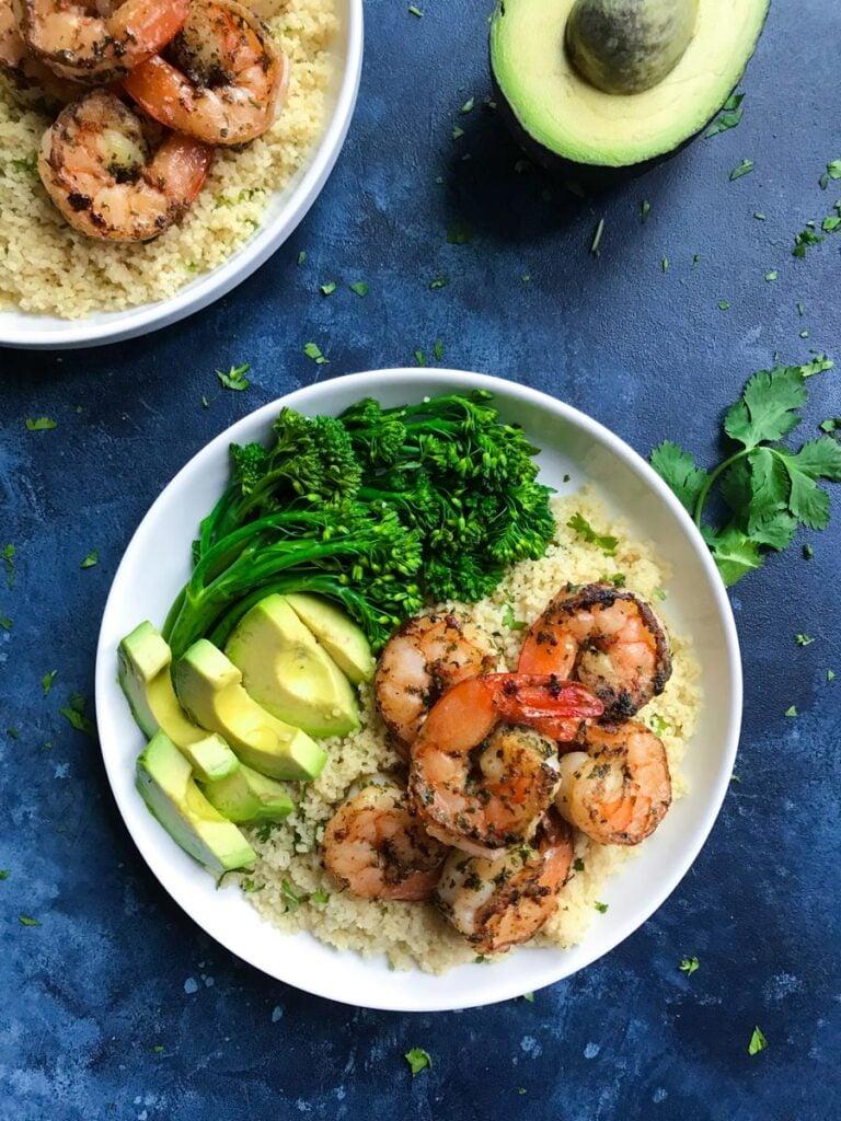 cilantro lime shrimp served with broccolini and avocado
