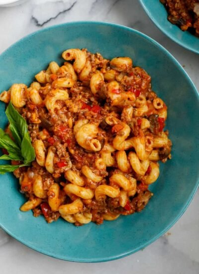 ground beef pasta cooked and served on a blue plate