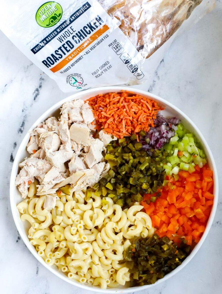 macaroni salad ingredients in a bowl