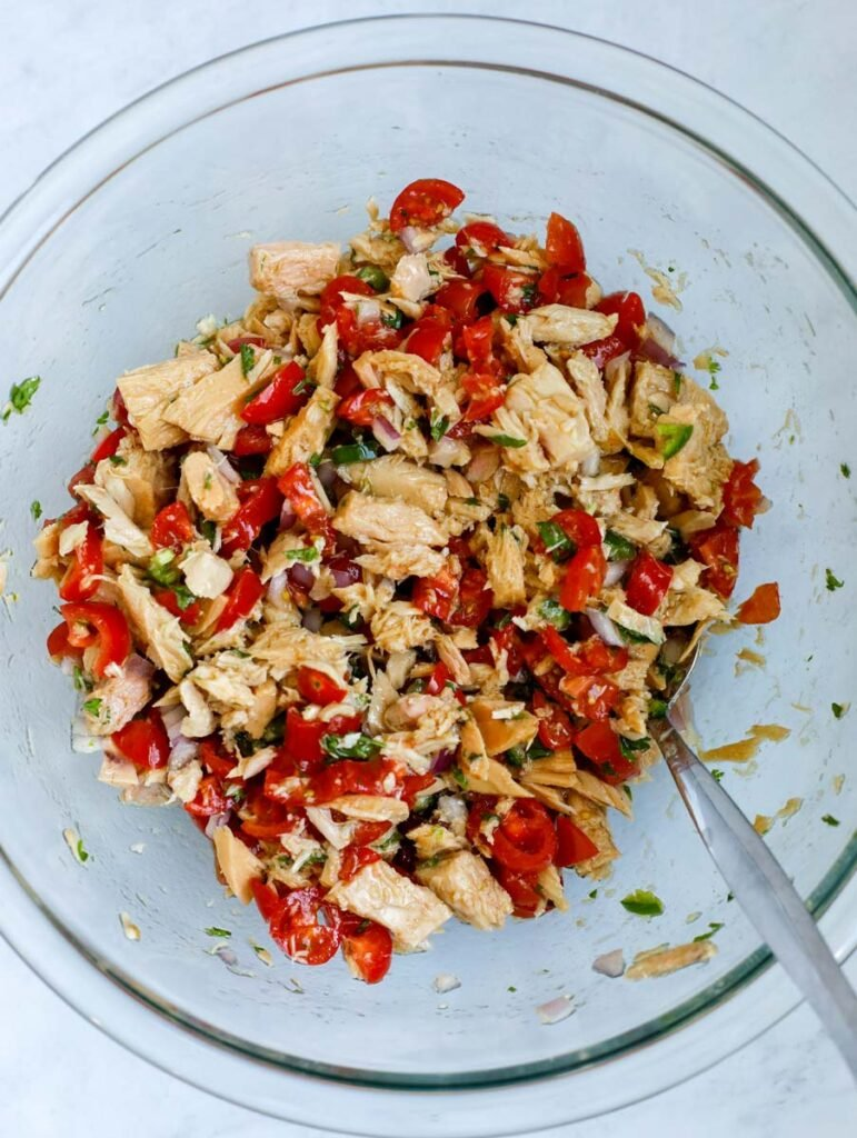 mixing tuna and tomatoes