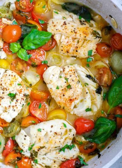 top donw shot of Oven Baked Cod in a white skillet