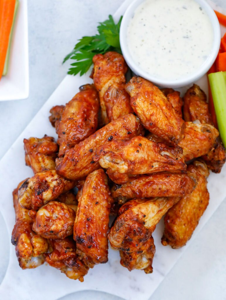 top donw shot of Air Fryer Chicken Wings with a dip.