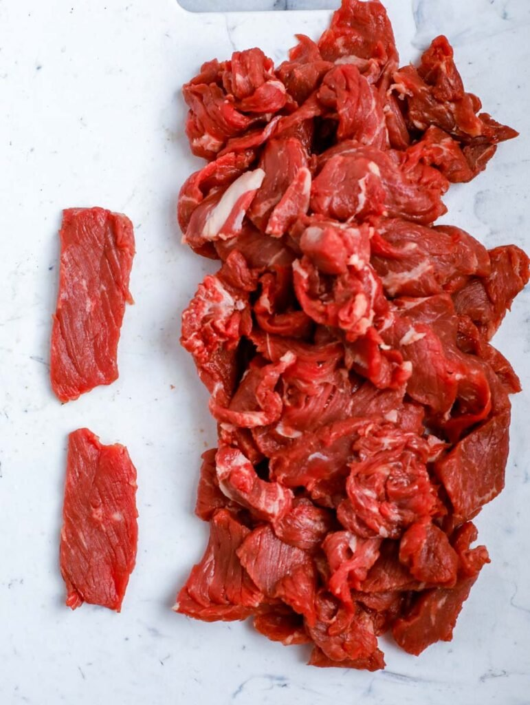 sliced beef on a counter top