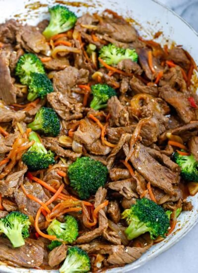 overhead shot of Beef and Broccoli Stir Fry in a white bowl