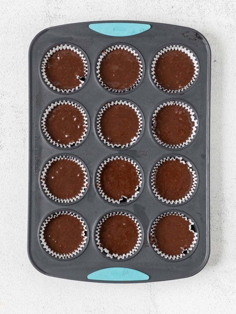 chocolate cupcake batter in muffin pan
