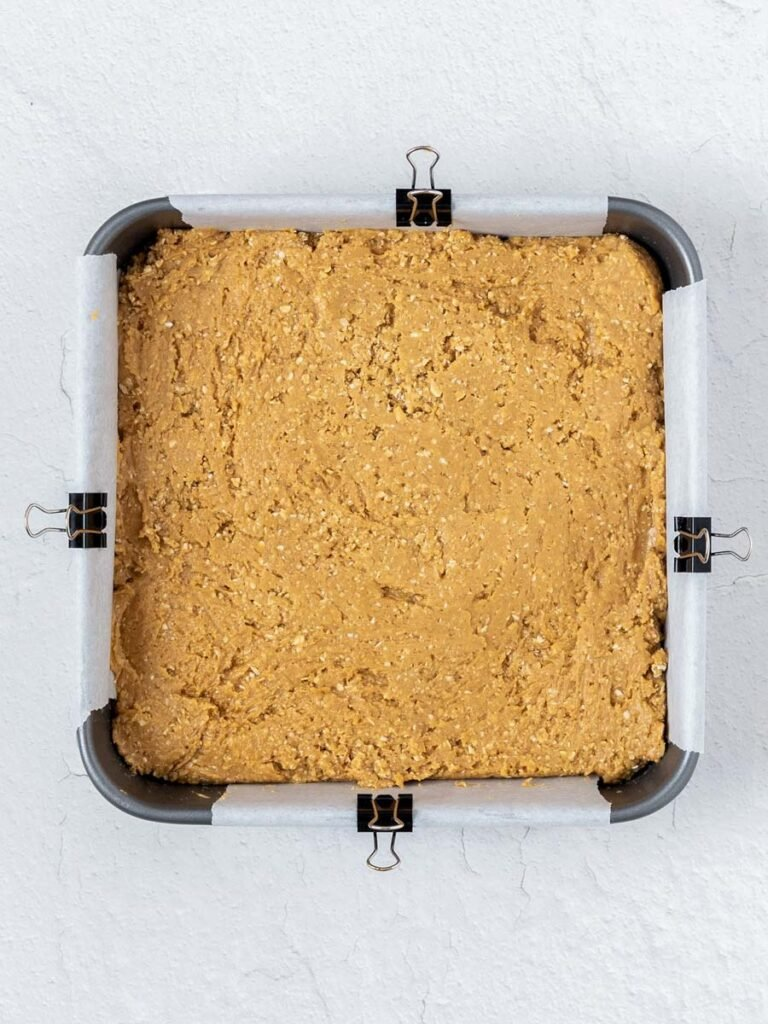 top down shot of the peanut butter mixture in a square pan