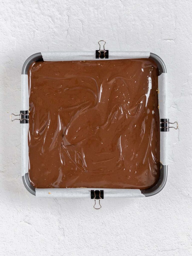 the mixture of the bars in a square pan after it's assembled