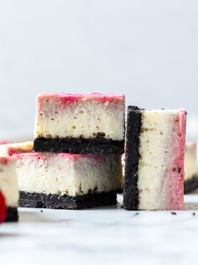 two cheesecake bars stacked up with one on the side